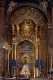 Virgen del Pilar con manto y medalla de la Cofradía.
